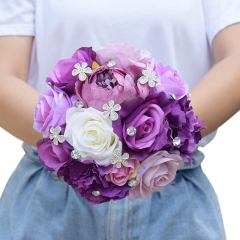 Bridesmaid Holding Bouquet with Rhinestone Decoration